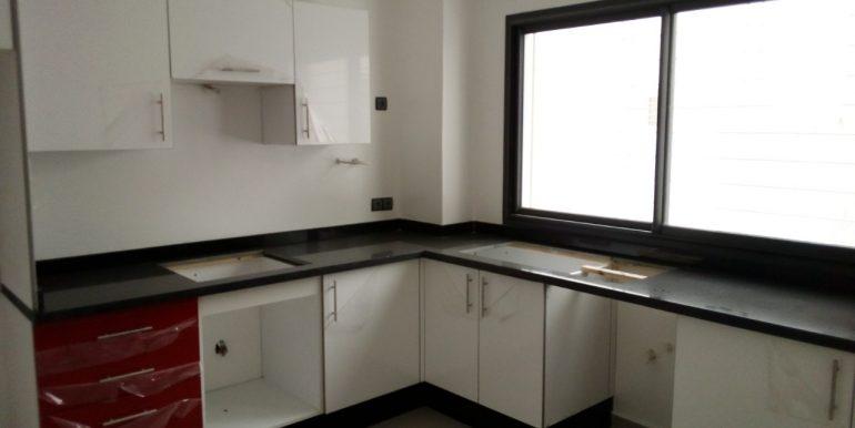 Appartement au 1er étage dans un immeuble avec garage à vendre
