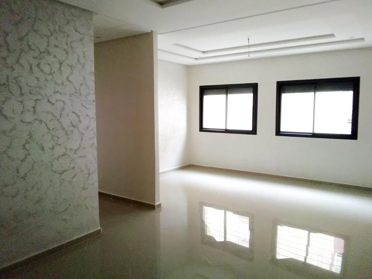 Appartement au 1er étage dans un immeuble avec garage